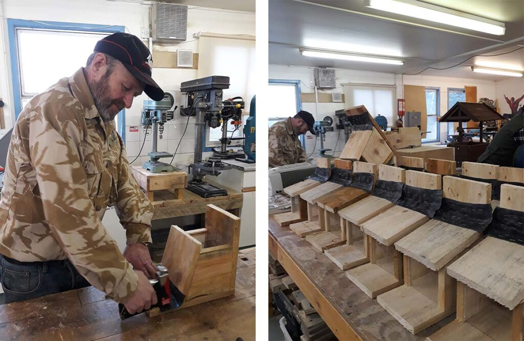 1. Man stapling waterproof hinge to wooden feeder box. 2. Row of feederboxes on workshop table